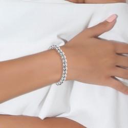 Pulsera decorada con perlas...