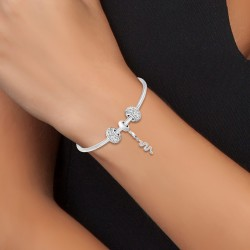 Charm and steel bracelet by...
